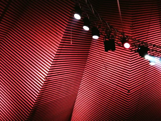 Popkultur Geht Schnell Indoors  Lighting Equipment Red Illuminated Low Angle View Lights Berlin Photography Tempodrom Ceiling Lights Concert Photography Spot On Red Black Concert