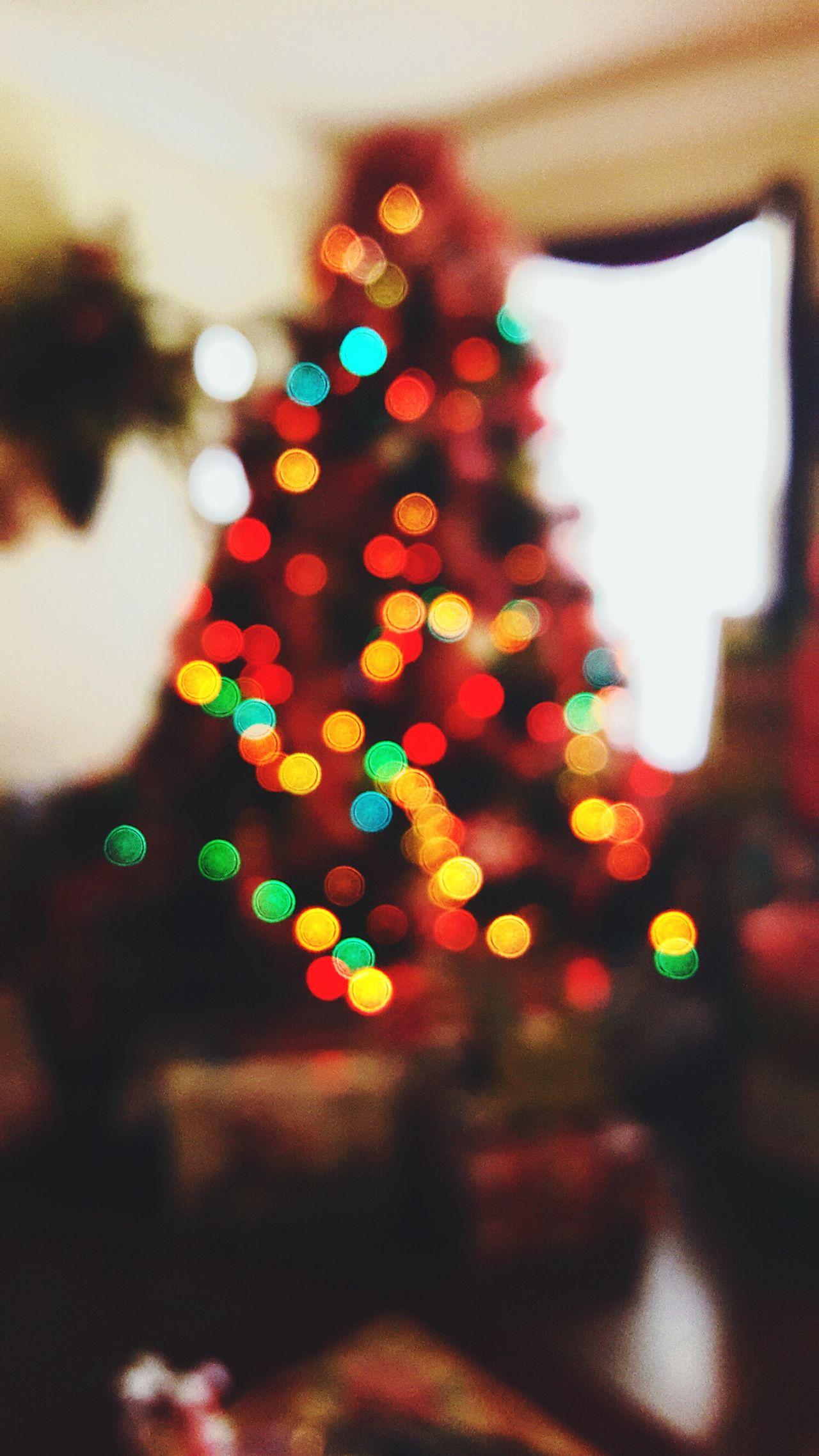 Christmas tree 💕🎊 Christmas Christmas Tree Defocused Celebration Christmas Lights Illuminated No People Christmas Decoration Tree Multi Colored Christmas Ornament Tradition Bokeh Bokeh Lights Bokeh Photography