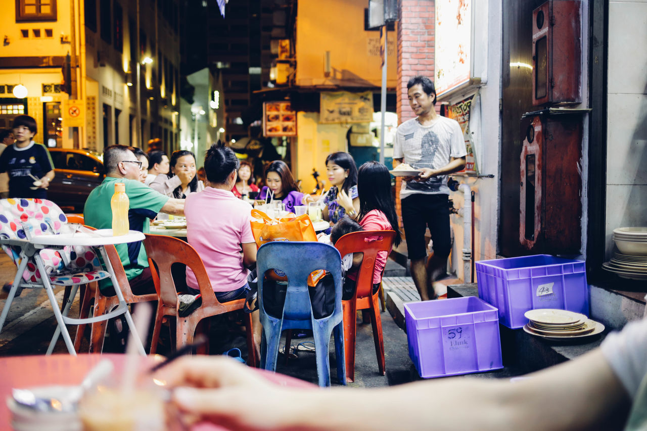 Aisan ASIA Asian Family City City Life City Life Culture Food And Drink Foosball Large Group Of People Medium Group Of People Restaurant Singapore Sitting South East Asia Street Travel Wanderlust