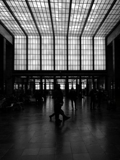 Nowhere, Indoors  Lifestyles Architecture Built Structure Real People Ceiling Large Group Of People People Railroad Station Waiting Room Black And White Photography Welcome To Black Art Is Everywhere The Architect - 2017 EyeEm Awards Black And White Friday EyeEm Ready   The Graphic City