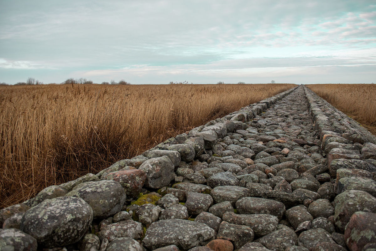 Cloud - Sky Day Green Sky Latvia Nature No People Outdoors Road Road To The Sea Road Trip Rock Rock Background Stone Jetty Stone Path Tourism Tourist Trail Vintage