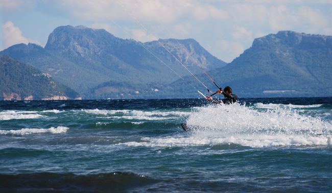 Real People Sea Waterfront Lifestyles Mountain Water Leisure Activity Sport Beauty In Nature One Person Motion Adventure Extreme Sports Men Outdoors Transportation Mountain Range Scenics Sky Kitesurfing Mallorca Alcudia Day Wave Kiteboarding