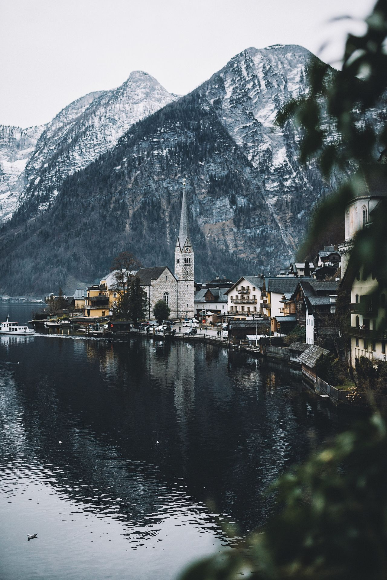 Hallstatt evenings. Austria Hallstatt Vscofilm Architecture Mountain Built Structure Mountain Range Building Exterior Water Reflection Sky Religion Travel Destinations No People River Outdoors Waterfront Place Of Worship Nature Bridge - Man Made Structure Day