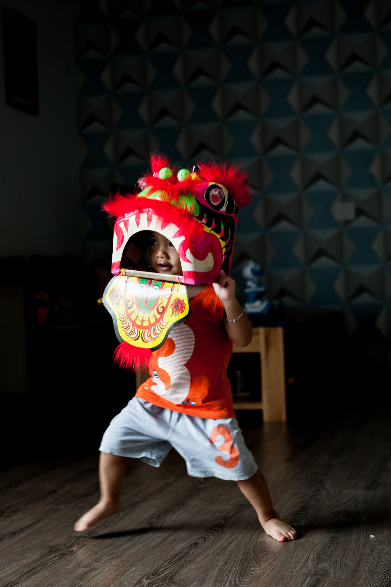 A kid is wearing a lion mask, dancing around his home, like the lion dance that he saw on Pagoda. Child Childhood Costume Dancing Full Length Fun Habit Indoors  Kids Playing Lion Dance One Person Performance Real People The Portraitist - 2017 EyeEm Awards