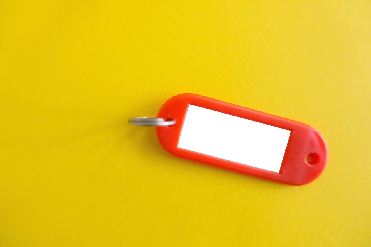 copy space, studio shot, red, indoors, yellow, close-up, no people, yellow background, day