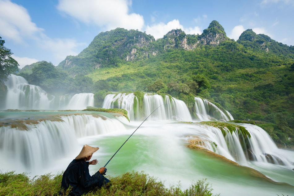 Sky, earth, human, all become one in a moment. A tranquil moment of the sky and the earth. Ban Gioc Ban Gioc Waterfall BanDoc Fisherman Natural Beauty Nature Vietnam Vietnamese Waterfall
