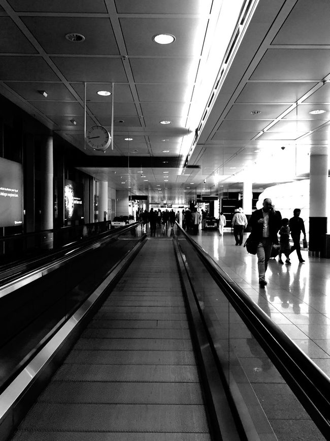 Always running ... everyone's just passing by ... 🚶🏻 Tadaa Community Taking Photos Snapshots Of Life Blackandwhite Monochrome Mpro From My Point Of View IPhoneography Der Reisende Fortheloveofblackandwhite Black & White EyeEm Best Shots - Black + White Urbanphotography People Walking  Airport Urban Geometry Hello World Structure Light And Shadow Random People Munich Airport