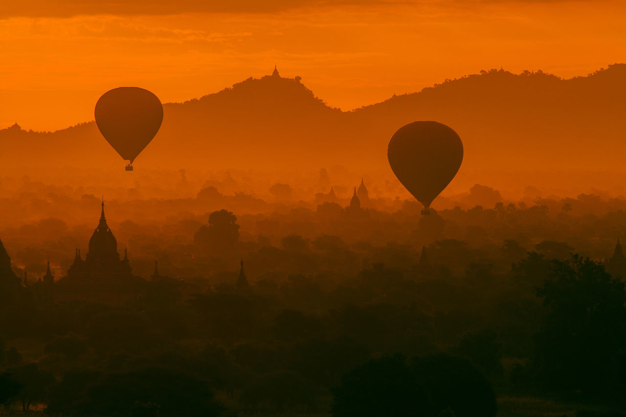 Ballooning over Bagan Ancient Beauty In Nature People And Places Hot Air Balloon Idyllic Illuminated Majestic Mountain Range No People Non-urban Scene Orange Color A Bird's Eye View Pagoda Remote Scenics Stupa Tourism Tourist Attraction  Tranquility Travel Destinations UNESCO World Heritage Site My Year My View