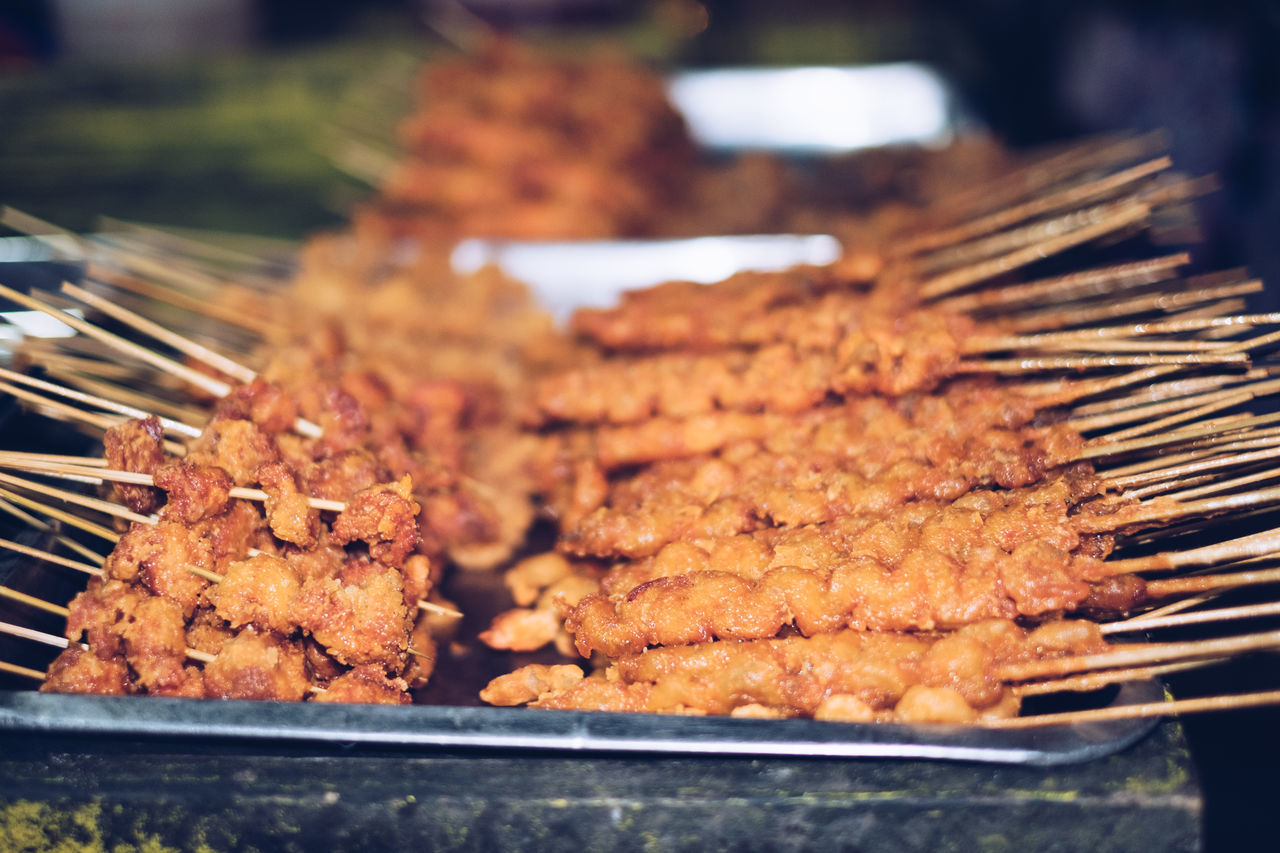 Street food: BBQ Chicken and Isaw Barbecue Barbecue Grill Chicken Chicken Barbecue Chicken Intestine Close-up Exotic Focus On Foreground Food Food And Drink Freshness Grilled Intestines Night Photography Outdoors Philippines Platter Skewer Street Food Street Photography