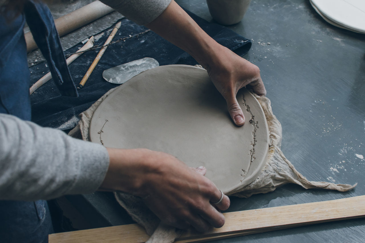 Adult Art And Craft Artist Authentic Business Ceramic Clay Close-up Creative Cup Hands At Work Indoors  Making Manual Worker One Person Owner People Potter Process Professional Skill  Table Woman Workshop