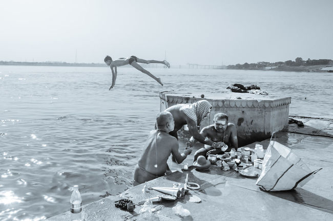 Morning Raga on Benaras Ghats Astrology Sign Diver Drowning Ganges Ghats Of Varanasi Monochrome Photography Outdoors Rituals & Cultural Sky Varanasi, India Ganges, Indian Lifestyle And Culture, Bathing In The Ganges, Water