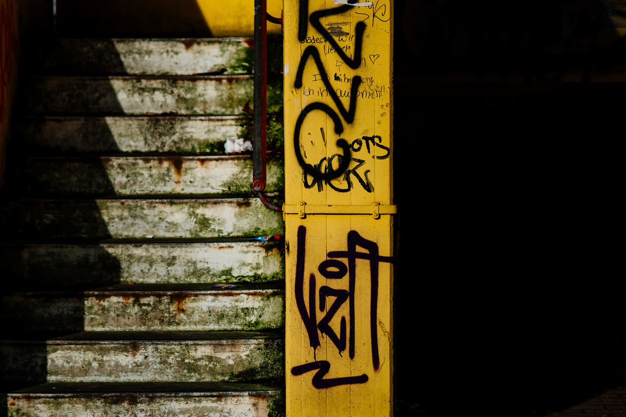Stairs & Shadows | Architecture Bonjour Tristesse Built Structure Concrete Day Graffiti Light Light And Shadow No People Outdoors Stairs Stairs & Shadows Sunlight Sunlight And Shadow Tags Tristesse Yellow