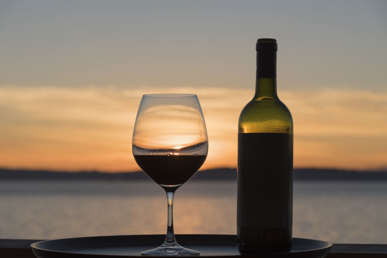 Wine tasting by the sea at sunset Alcohol Alcoholic Beverages Aperitif Beach Close-up Cloud - Sky Drink Drinking Glass Nature No People Outdoors Red Wine Sea Sky Sunset Sunset Silhouettes Tasting Water Wealth White Wine Wine Wine Bottle Wineglass Winery Winetasting
