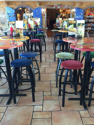 Blue Seat Green Seat Antigua Airport Corona Airport Scenery Airport Food Airport Restaurant Seating Multi Colors Food Orange Table Yellow Table Blue Shutters