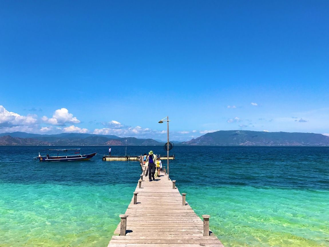 Let's Walk to My Little Paradise Sea Water Blue Nature Beauty In Nature Scenics Tranquility Day Sky Real People Vacations Outdoors Men Jetty Full Length Clear Sky Horizon Over Water Mountain People EyeEmNewHere Sommergefühle EyeEm Selects MELeverywhere MELeverywhereTrip