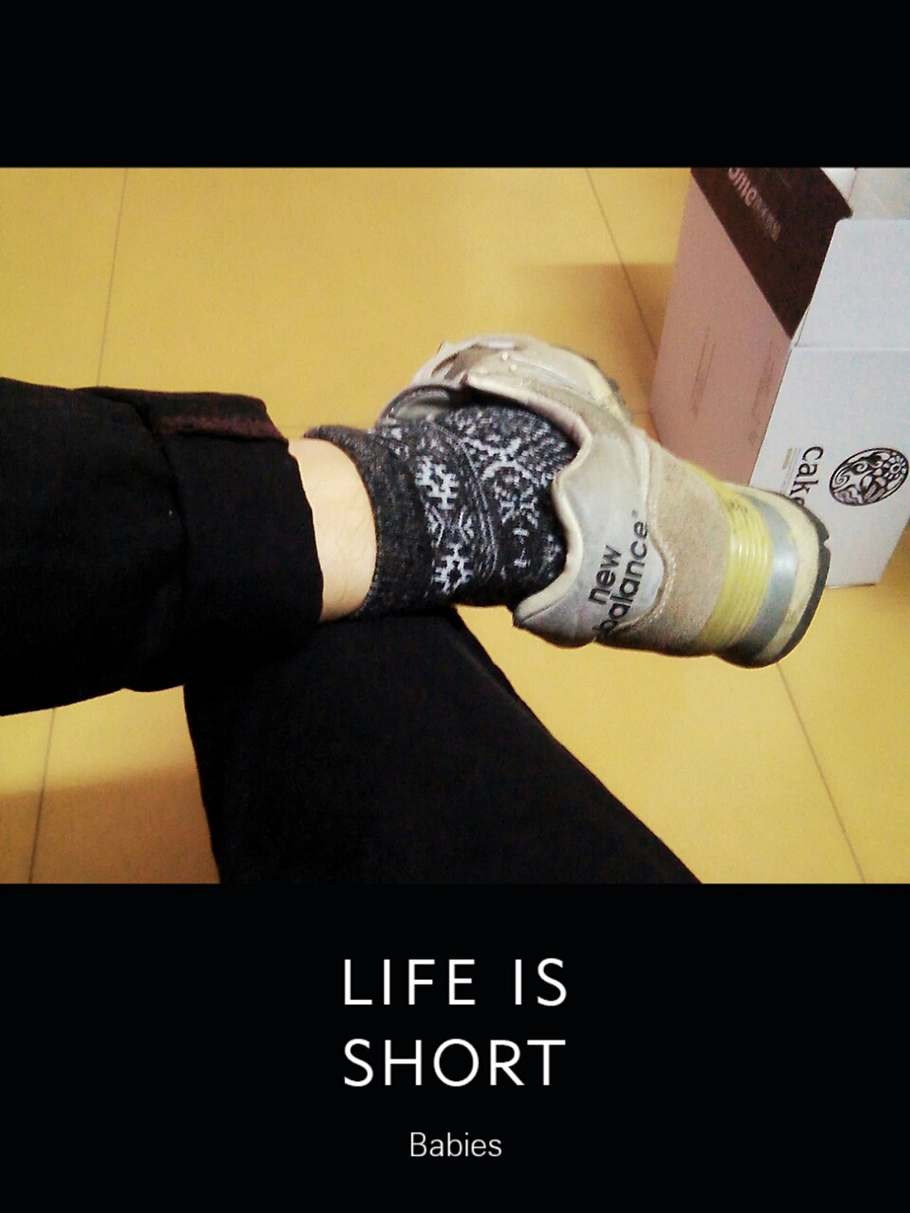 communication, text, low section, indoors, western script, person, men, lifestyles, shoe, leisure activity, number, part of, high angle view, close-up, connection, technology, human foot