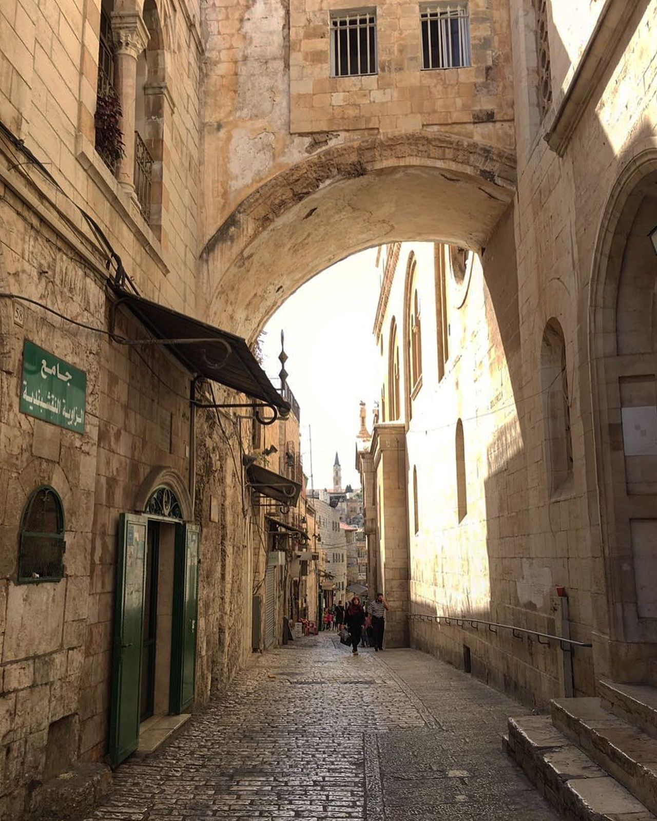 Empty beautiful and ancient streets of Jerusalem, Israel Ancient Architecture Beautiful Bricks Brickstones Building Exterior Built Structure Doors Holy City Israel Jerusalem Light Outdoors Religions Shadow Sun The Way Forward Tourist Destination Travel Destination Walls Windows