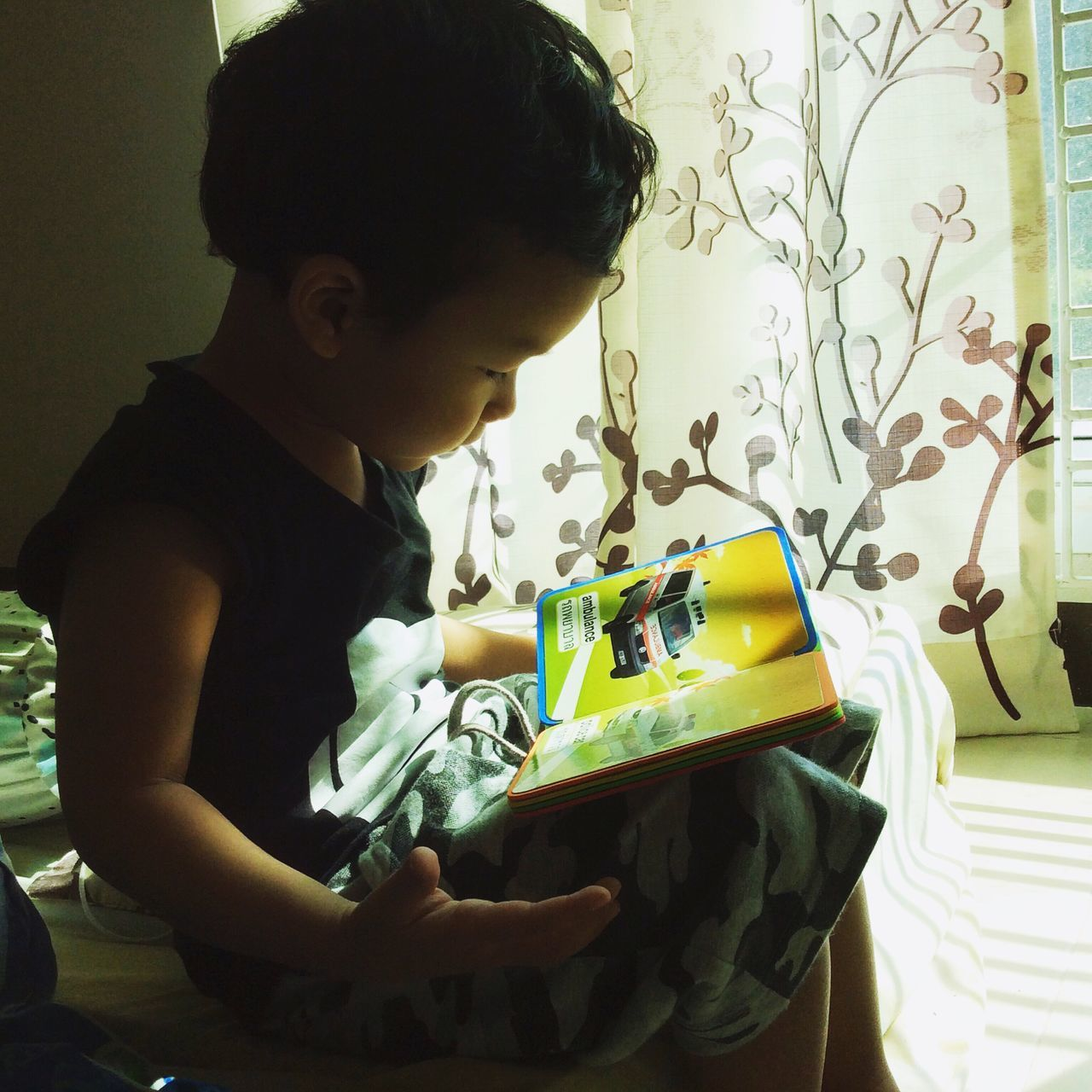 One Person Real People Looking Down Childhood Lifestyles Indoors  Table Day People Boy Son Book Read Cute Child Study Learn People Attention Concentration