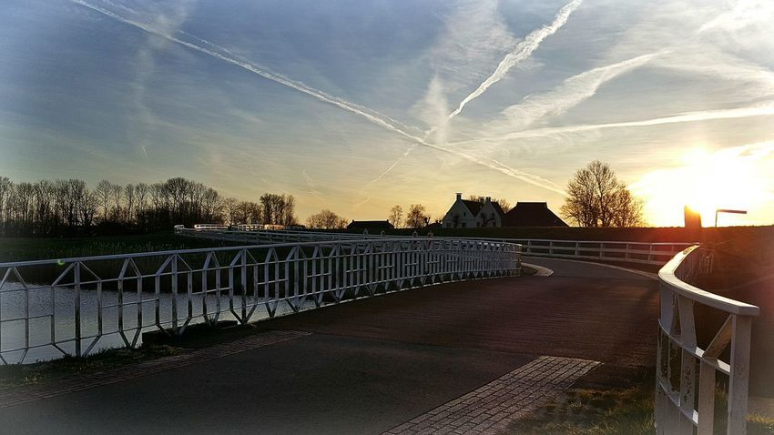 Fence Railing Sky No People Outdoors Tree Sunset Bridge - Man Made Structure Water Day Followme Architecture Boerenland Route Groninger Hoogeland Personal Perspective Mobile Photography Hollandse Luchten From My Point Of View Groningen