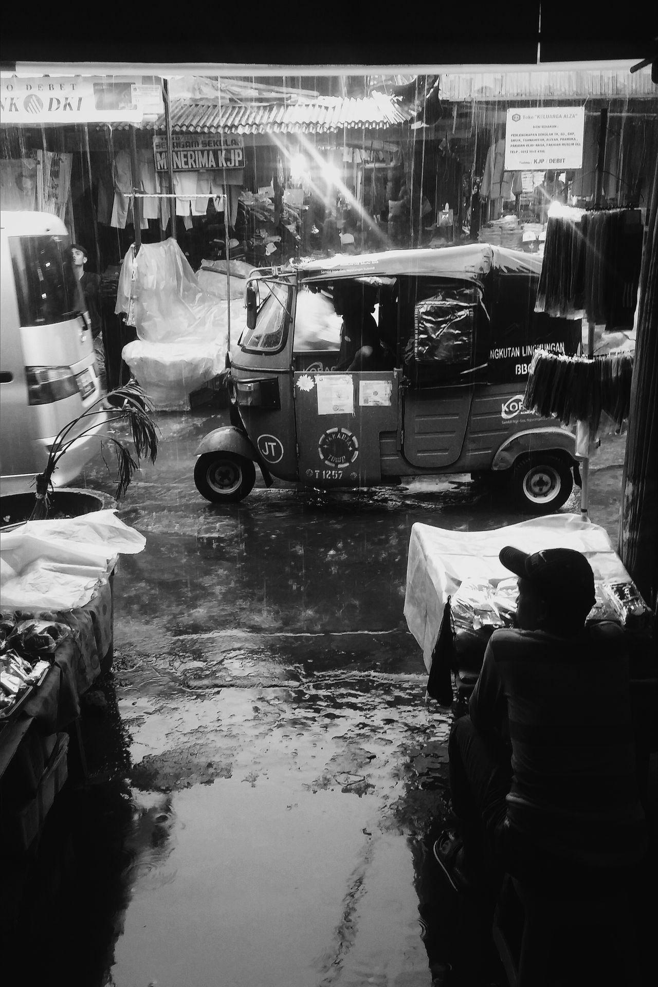 Transportation Wet Street Land Vehicle Mode Of Transport Rain Reflection Road Real People Rainy Monochrome Black And White Snap a Stranger Embrace Urban Life