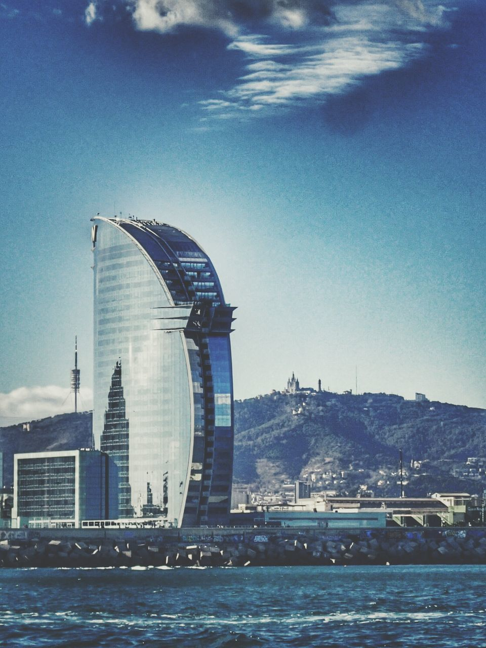 architecture, built structure, building exterior, sky, city, no people, day, river, water, waterfront, travel destinations, ferris wheel, outdoors, cityscape, skyscraper, nautical vessel, nature