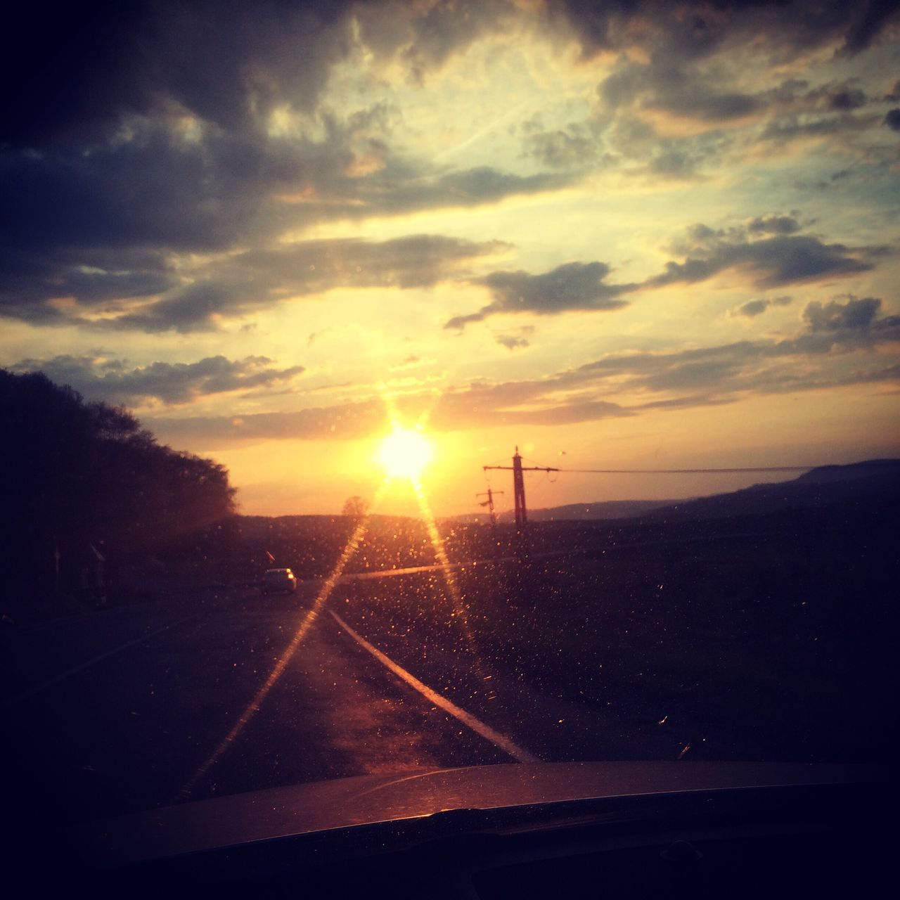 sunset, transportation, road, sky, no people, sun, car, scenics, nature, beauty in nature, cloud - sky, tranquil scene, silhouette, landscape, outdoors, tree, day