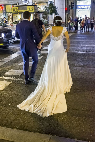 Bride and Groom in Gran Via Madrid during a photo shoot. City Life Taking Photos Traffic Architecture Bride Bridegroom Celebration City Editorial  Groom Life Events Lifestyles Love Men Outdoors Real People Street Togetherness Walking Wedding Wedding Day Wedding Dress Well-dressed Women