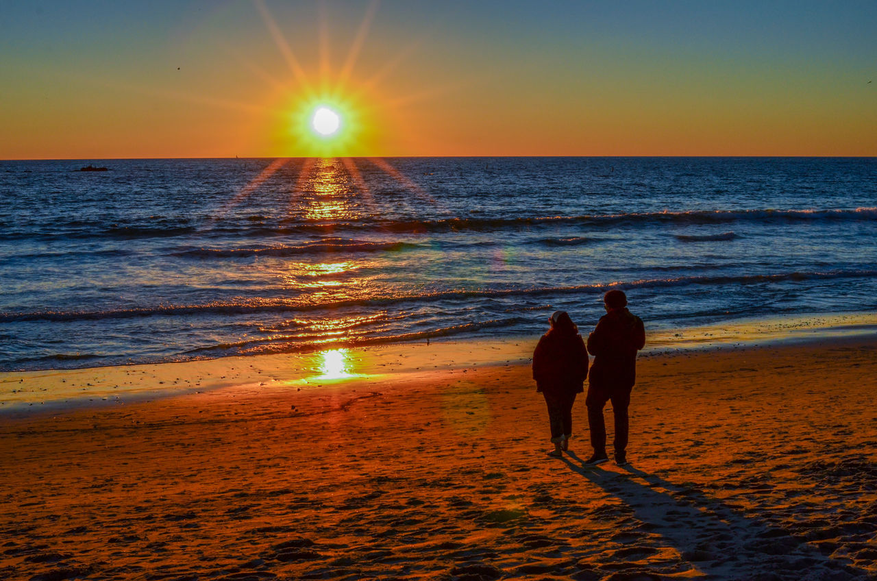 A couple is watching the sunset together at Santa Monica Beautiful Day Beauty In Nature Capture The Moment Couple Horizon Over Water Love Story Sunset Travel