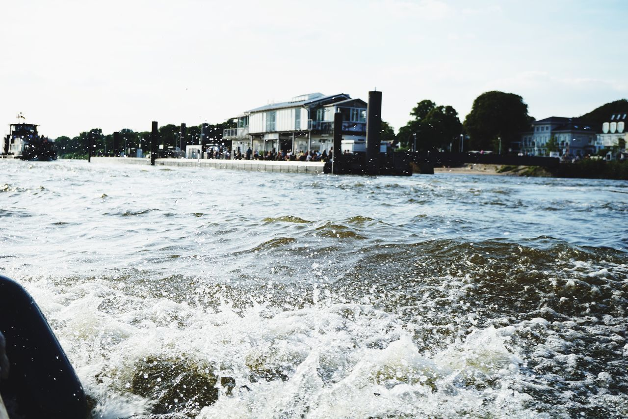 water, motion, architecture, built structure, wave, no people, day, outdoors, building exterior, sky, city, sea, nature, tree