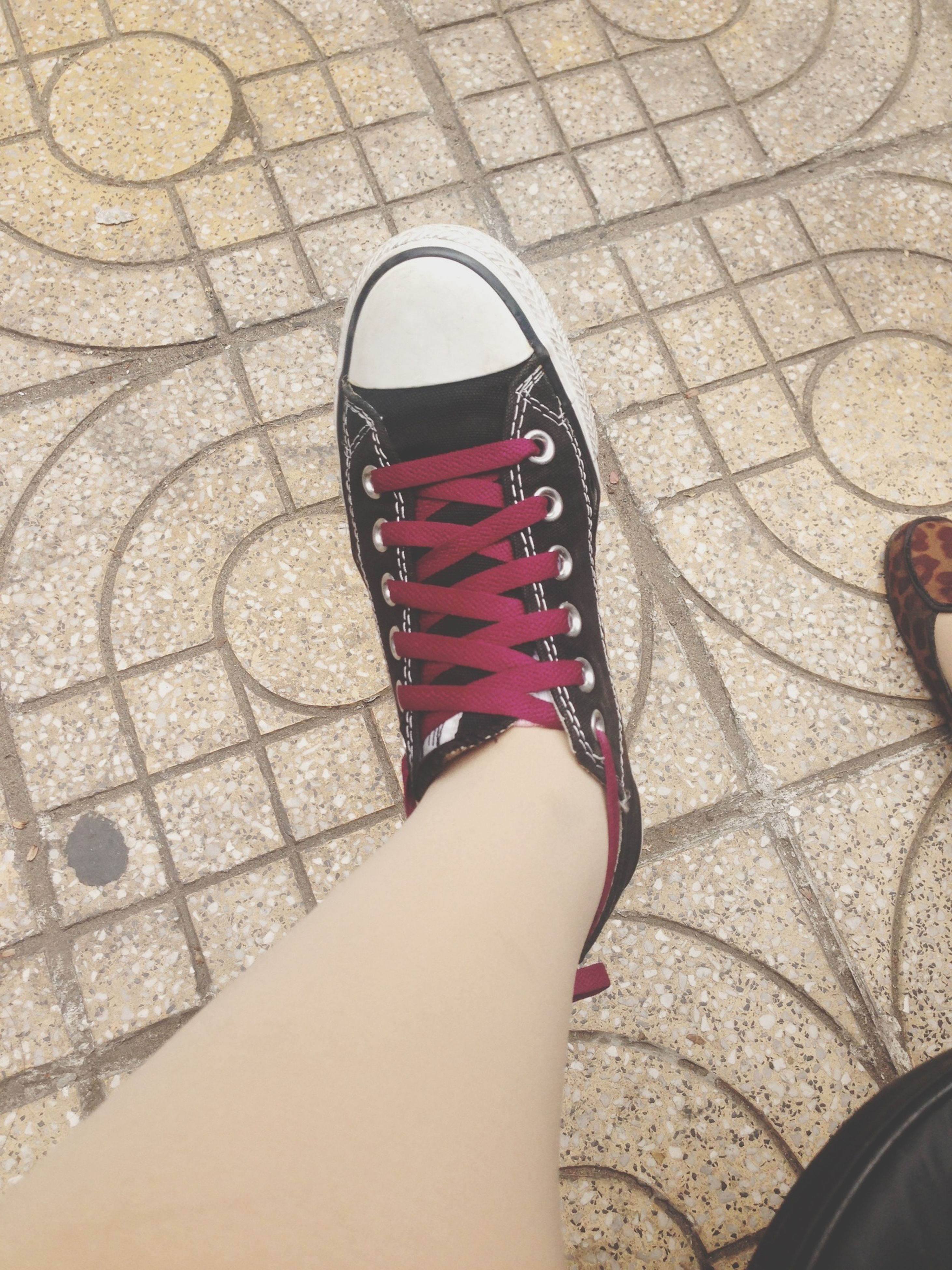 low section, person, lifestyles, personal perspective, shoe, standing, high angle view, leisure activity, pattern, cobblestone, human foot, part of, directly above, day, footwear, tiled floor