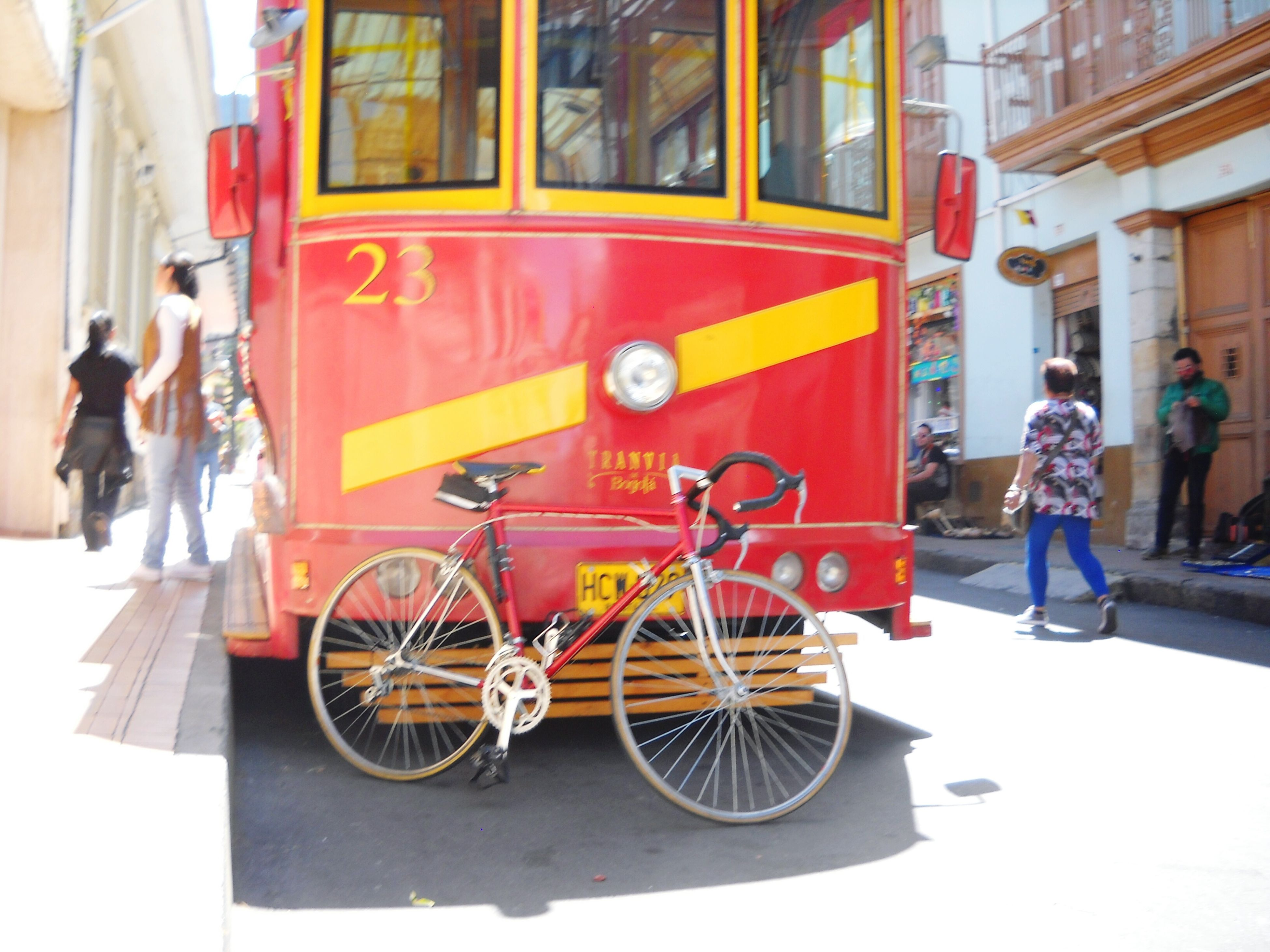 land vehicle, mode of transport, transportation, bicycle, outdoors, two people, stationary, city, city life, full length, day, real people, public transportation, men, people, adult