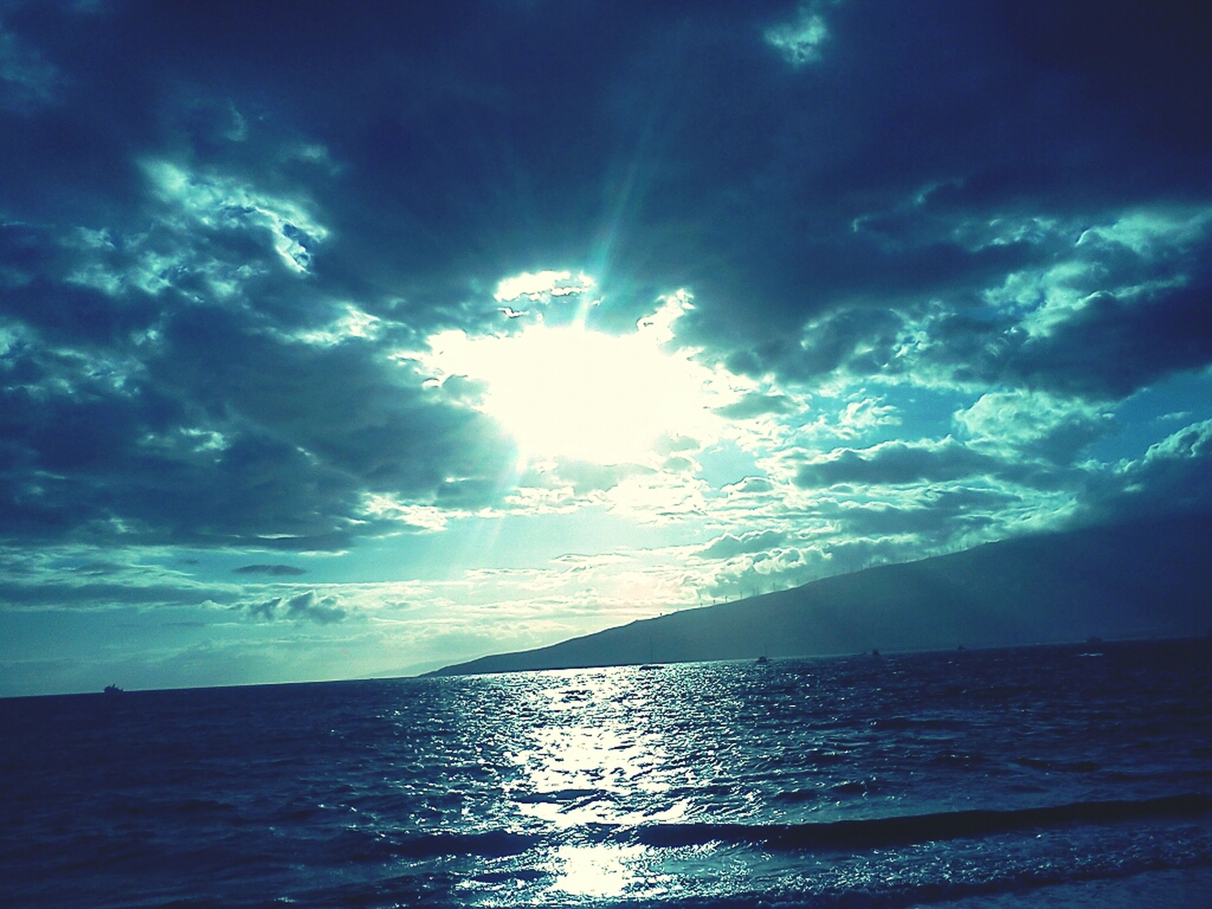 sea, sky, water, scenics, tranquil scene, tranquility, beauty in nature, cloud - sky, sun, horizon over water, sunbeam, nature, sunlight, idyllic, cloud, blue, waterfront, cloudy, reflection, outdoors