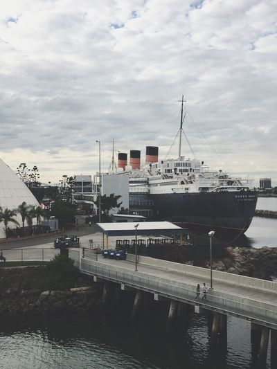 Queen Mary Long Beach Water Palm Tree Palm Trees Ocean Sky Built Structure Harbor Mode Of Transport Waterfront Outdoors Nature Nautical Vessel Moored Transportation No People Cloud - Sky Building Exterior Architecture Day River Mast Yacht Ferry