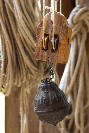 Making ropes the old way. Close-up Craftsmanship  Focus On Foreground Handmade Hemp Making Rope No People Old Part Of Pulley Block Rope Ropemaker Selective Focus Still Life Technology Weight Wood