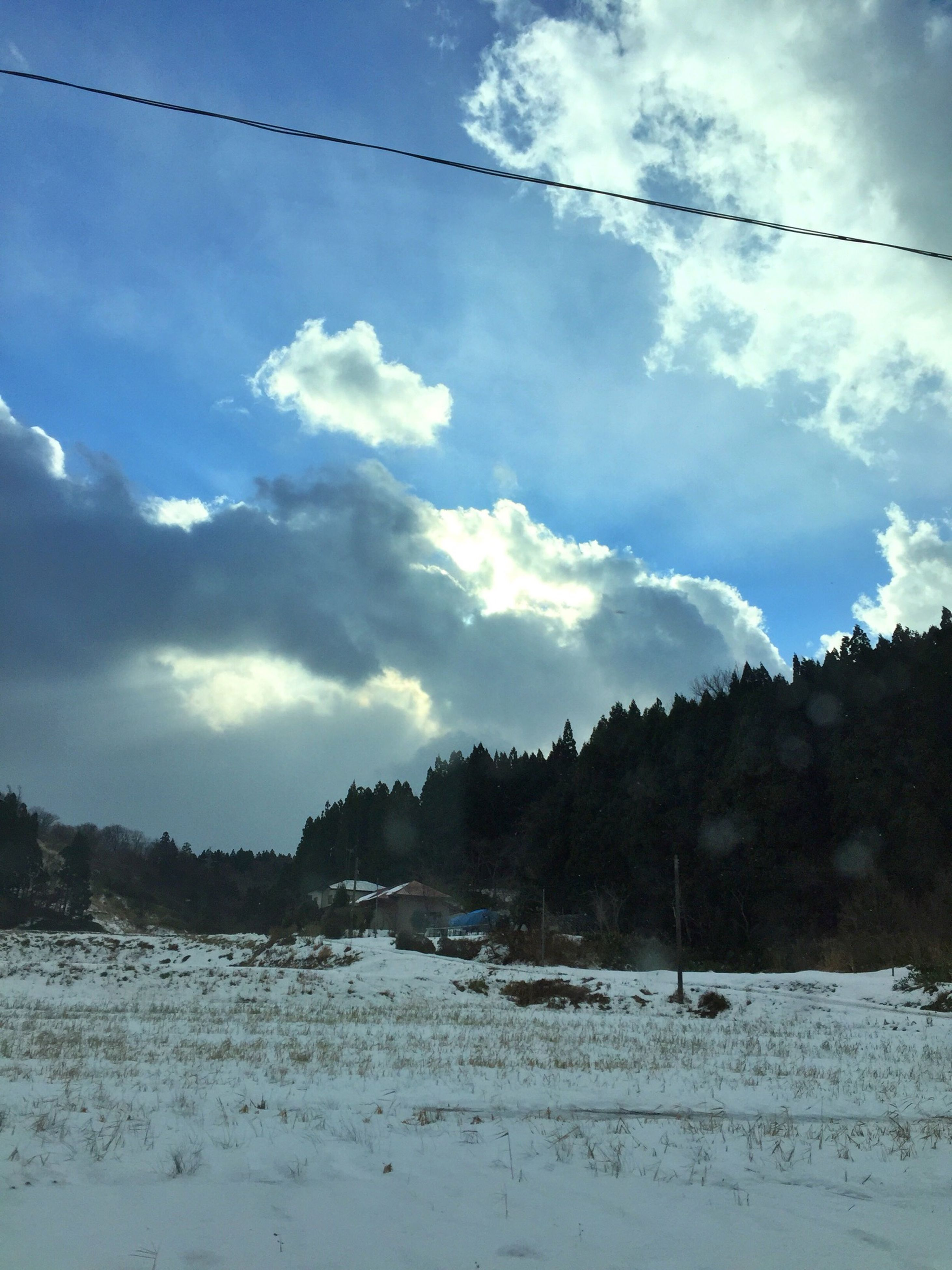 sky, cloud - sky, tranquil scene, tranquility, scenics, tree, cloud, beauty in nature, nature, cloudy, landscape, water, snow, day, outdoors, winter, non-urban scene, weather, no people, idyllic