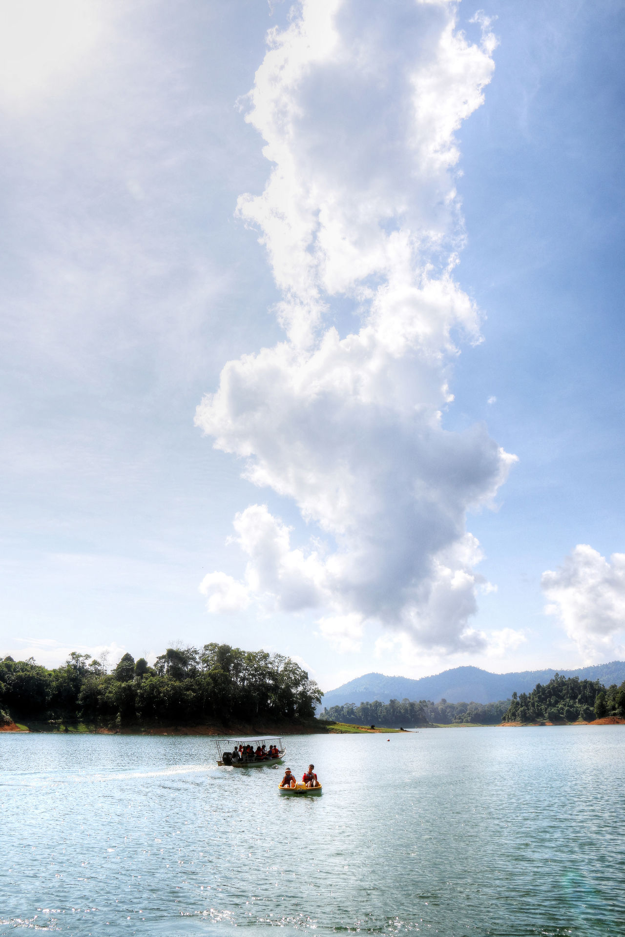 Kenyir Lake is the largest man-made lake in South-East Asia. Covering an area of 260,000 hectares, it is home to some 300 species of freshwater fishes Beauty In Nature Clouds Day Kenyir Kenyir Lake Malaysia Nature Nature Outdoors Resort Sky Terengganu Tourist Destination Tranquility Water