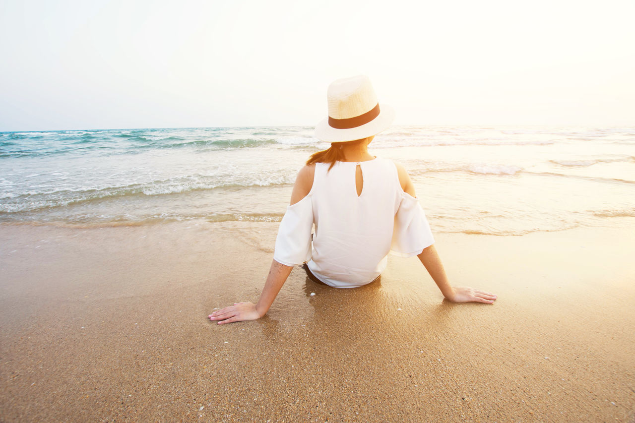 Adult Barefoot Beach Beach Holiday Blond Hair Carefree Childhood Day Full Length Horizon Over Water Leisure Activity Nature One Person Only Women Outdoors People Sand Sea Sky Summer Sun Hat Vacations