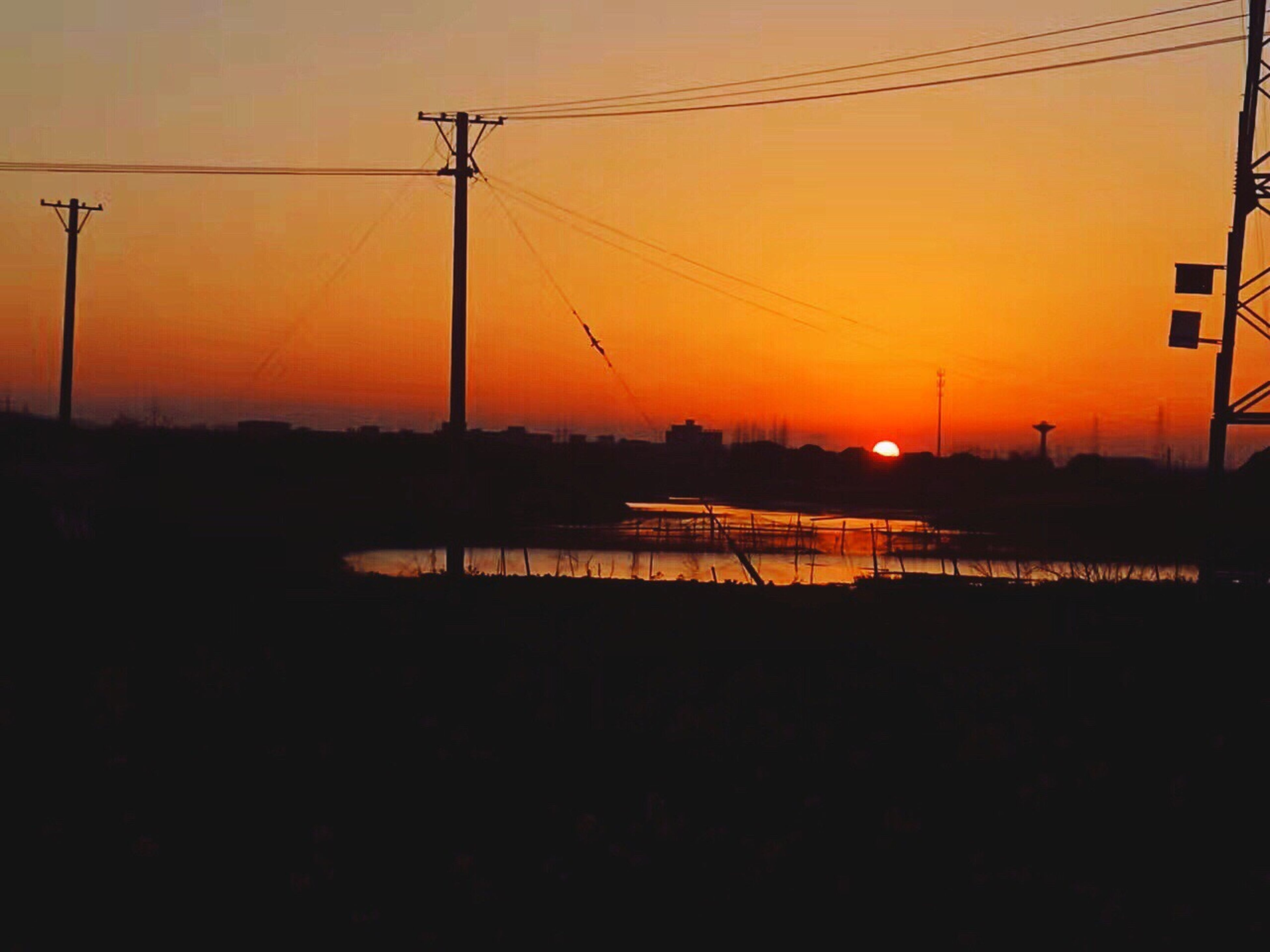 sunset, silhouette, electricity, outdoors, power line, no people, dramatic sky, sky, connection, illuminated, sun, beauty in nature, scenics, telephone line, electricity pylon