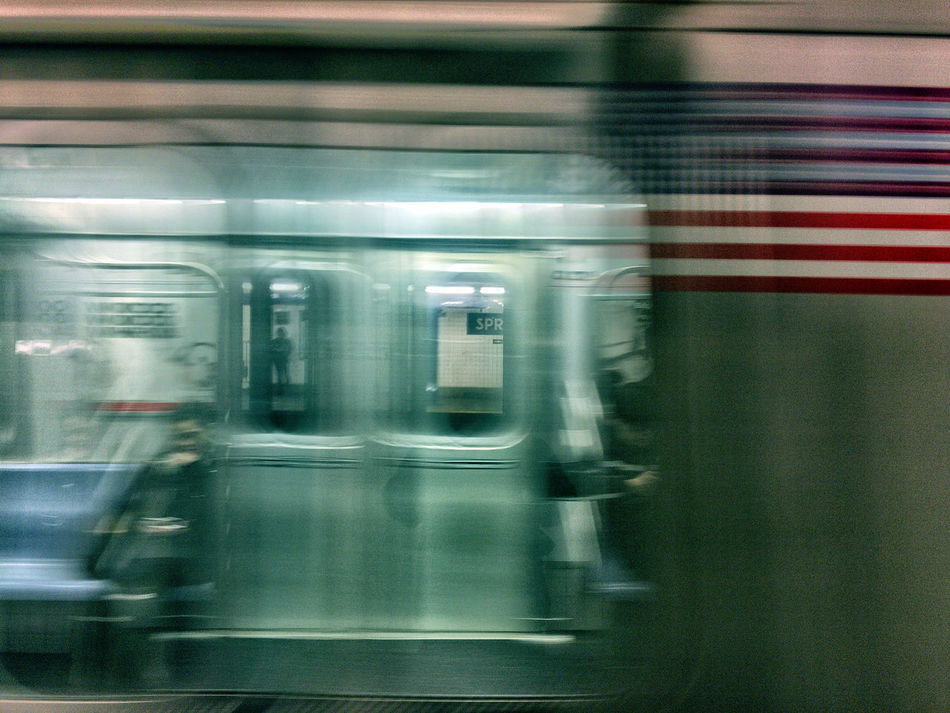The subway train arrives at NYC's Spring Street station. Blurred Motion Mode Of Transport Movement New York City NYC Photography In Motion Public Transportation Rail Transportation Railroad Station Railroad Station Platform Subway Subway Car Subway People Subway Station Train - Vehicle Transportation My Commute
