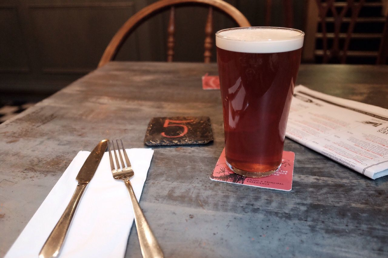 Beer Glass On Table In Restaurant