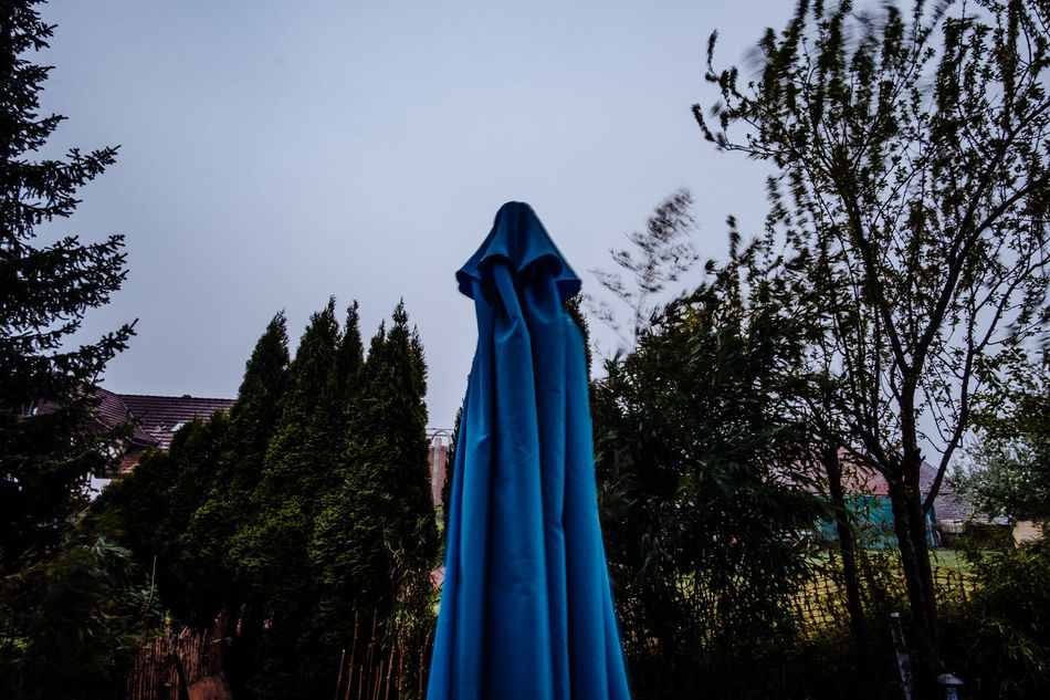 Blue Day Halloween Human Representation Low Angle View Nature No People Outdoors Sculpture Sky Statue Textile Tree
