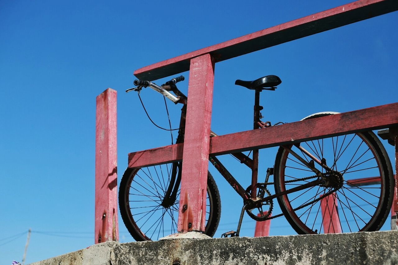 Low Angle View Of A Bicycle Against Clear Blue Sky