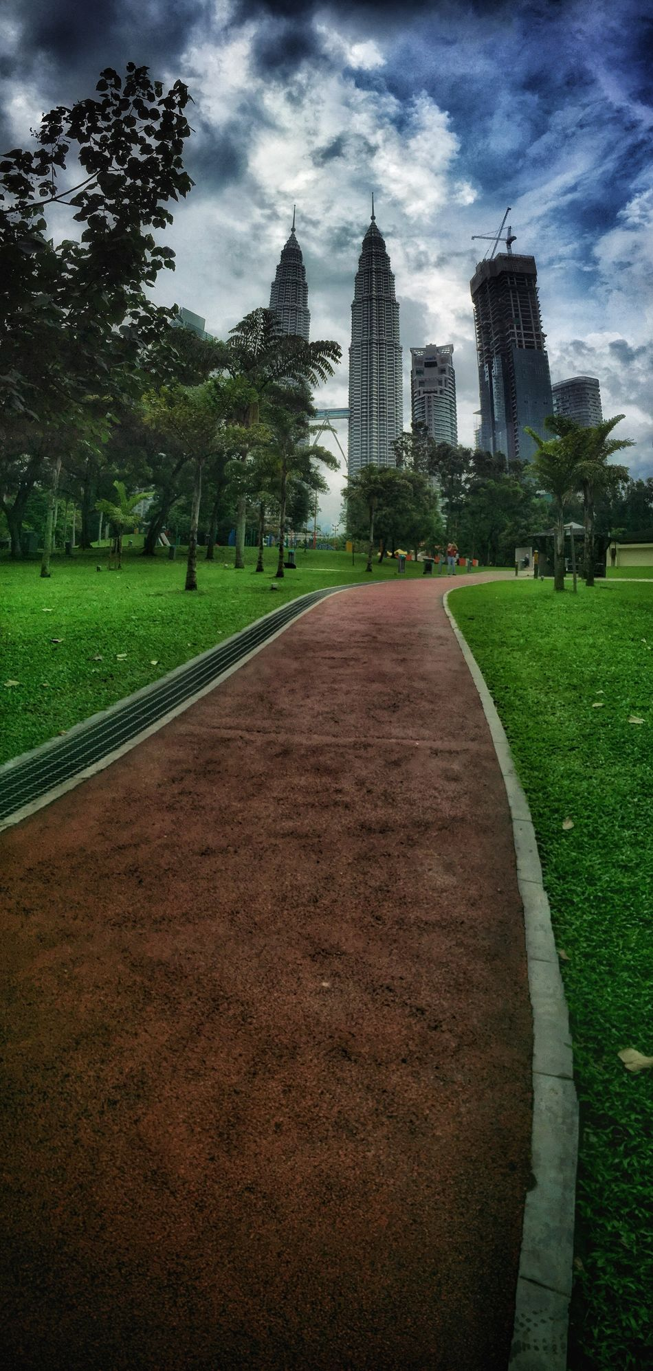 KLCC Park Tree Architecture Built Structure Grass Sky Building Exterior Cloud - Sky City Outdoors Road Skyscraper Travel Destinations Modern Day Cityscape Nature Architecture Modern Kuala Lumpur Twin Tower Petronas KLCC Park IPhone IPhoneography