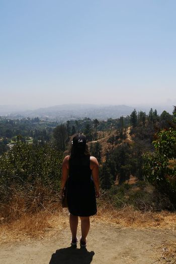 Sometimes we just need to hold on and breath Be. Ready. Clear Sky Day Full Length Justenjoytheview Landscape Losangeles Nature One Person Only Women Onlyme Outdoors People Photographing Plant Real People Rear View Sky Standing Tree Viewonla Women