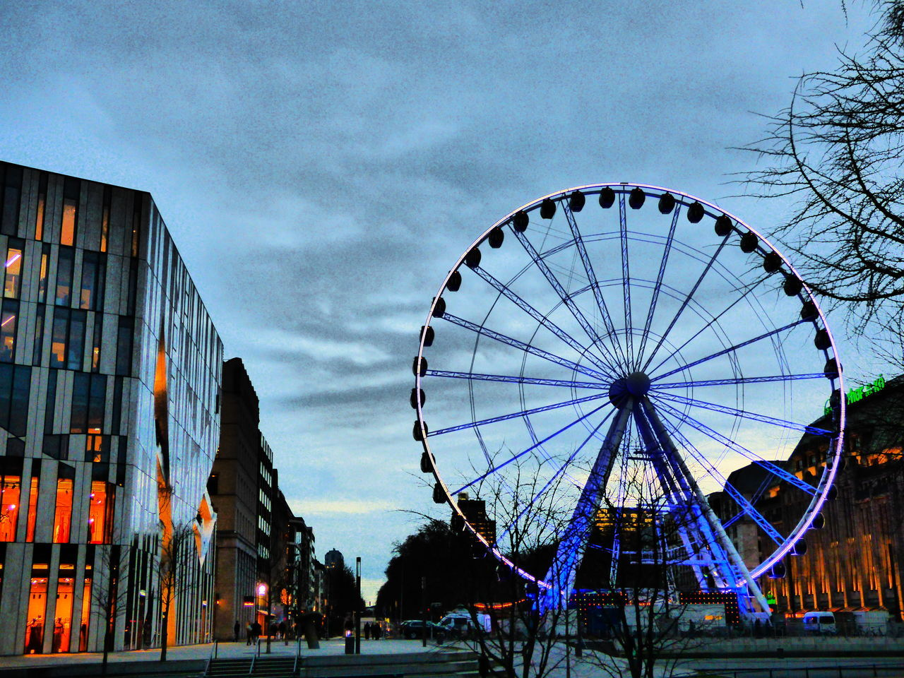 ferris wheel, low angle view, arts culture and entertainment, built structure, amusement park, architecture, sky, building exterior, outdoors, day, no people, big wheel