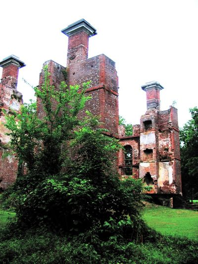 The Ruins of Rosewell Architecture Building Exterior Built Structure Day Exterior Grassy Green Green Color Growth Historical Building History Lawn Low Angle View Nature No People Old Outdoors Plant Rosewell Mansion Ruin Sky Tall - High The Past Travel Destinations Tree