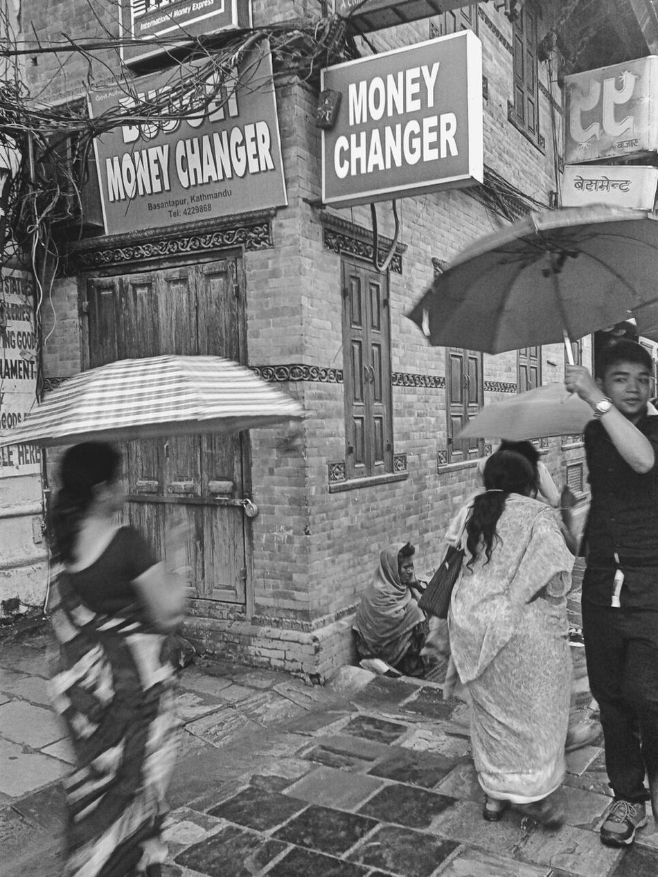Photography In Motion Blackandwhite Photography Streetphotography Nepal Umbrellas Basantapur Durbar Square People Photography Lifestyle