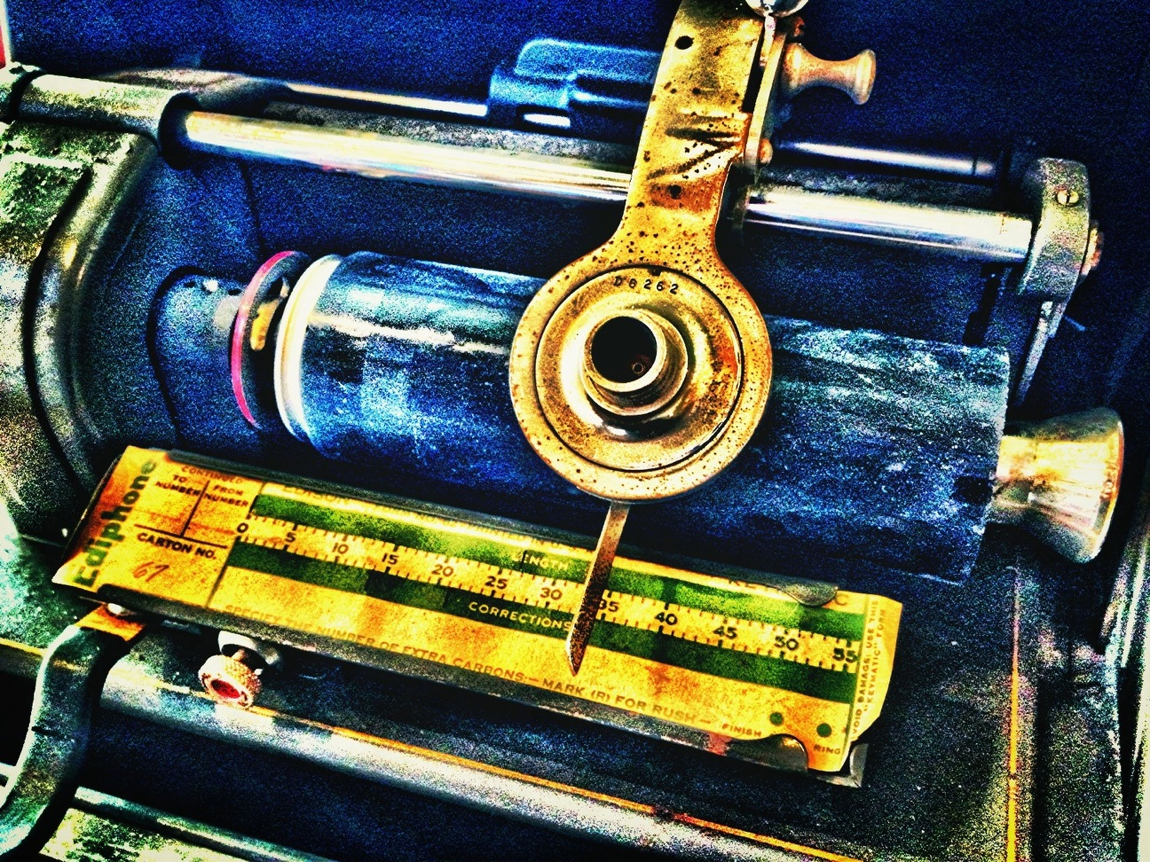 indoors, metal, high angle view, close-up, still life, yellow, old-fashioned, machinery, work tool, equipment, no people, old, retro styled, wood - material, metallic, music, industry, technology, machine part, transportation