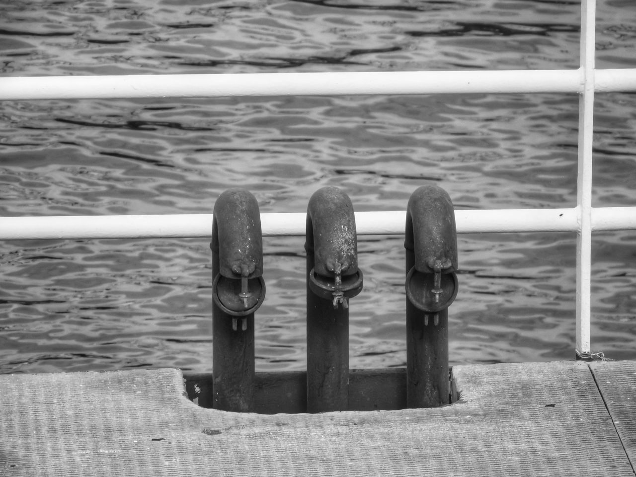 Beach Beautifully Organized Boat Dock Check This Out Close-up Day Docks EyeEm Best Shots High Angle View Metal Metallic Mooring Post Nature No People Outdoors Pier Railing Railings Rippled Rippled Water Riverside Three Of A Kind Water Waterfront Wave