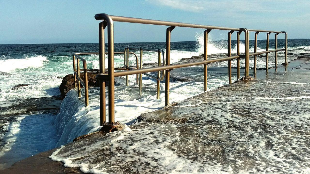 Newcastle Ocean Baths Nature IPhoneography Taking Photos Australia Hanging Out Enjoying Life Sunlight Ocean Sea Sea Spray Hand Rail Wave Water Blue